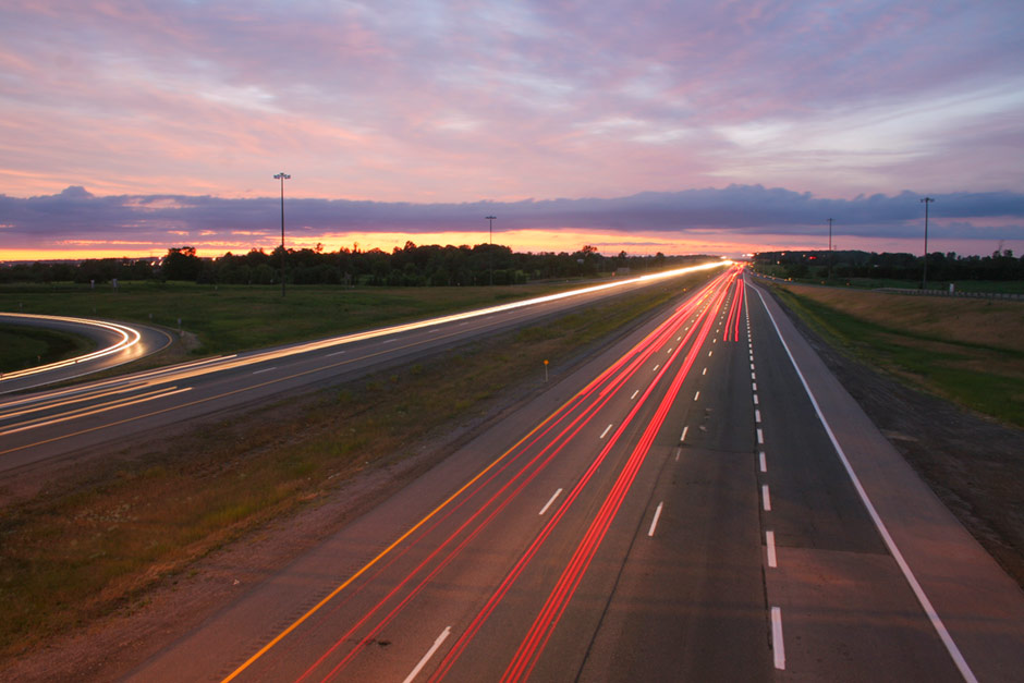 Traffic on highway at dusk with light trails - Free Stock Photo